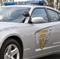 A trooper with the Ohio State Highway Patrol in Zanesville was injured when his cruiser was struck at a crash scene.