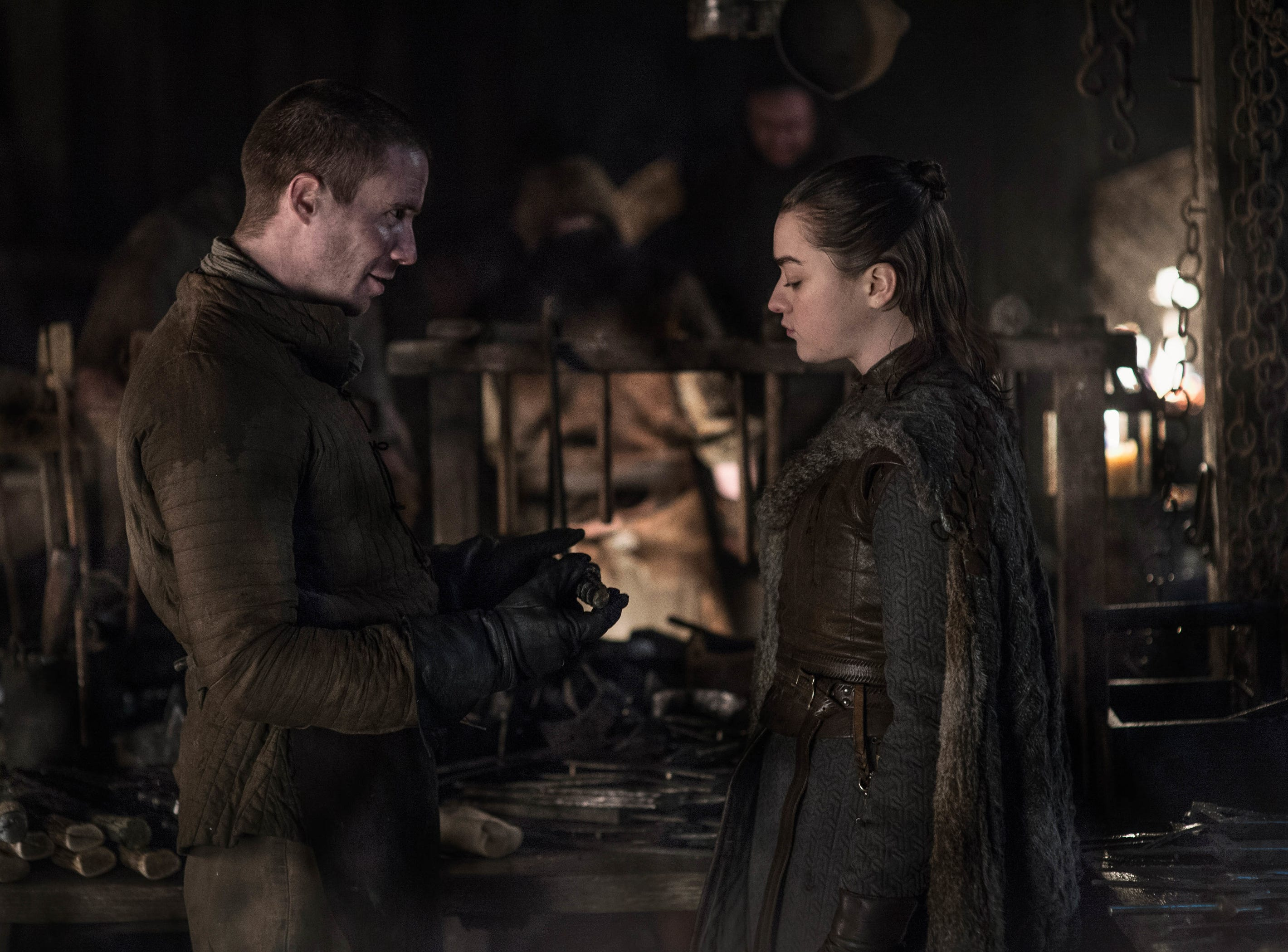 Arya Stark (Maisie Williams) asks Gendry (Joe Dempsie) for help on a project.