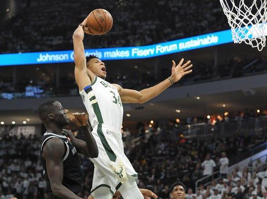 April 14: Bucks forward Giannis Antetokounmpo rises up for the monster one-handed slam during Game 1 against the Pistons.
