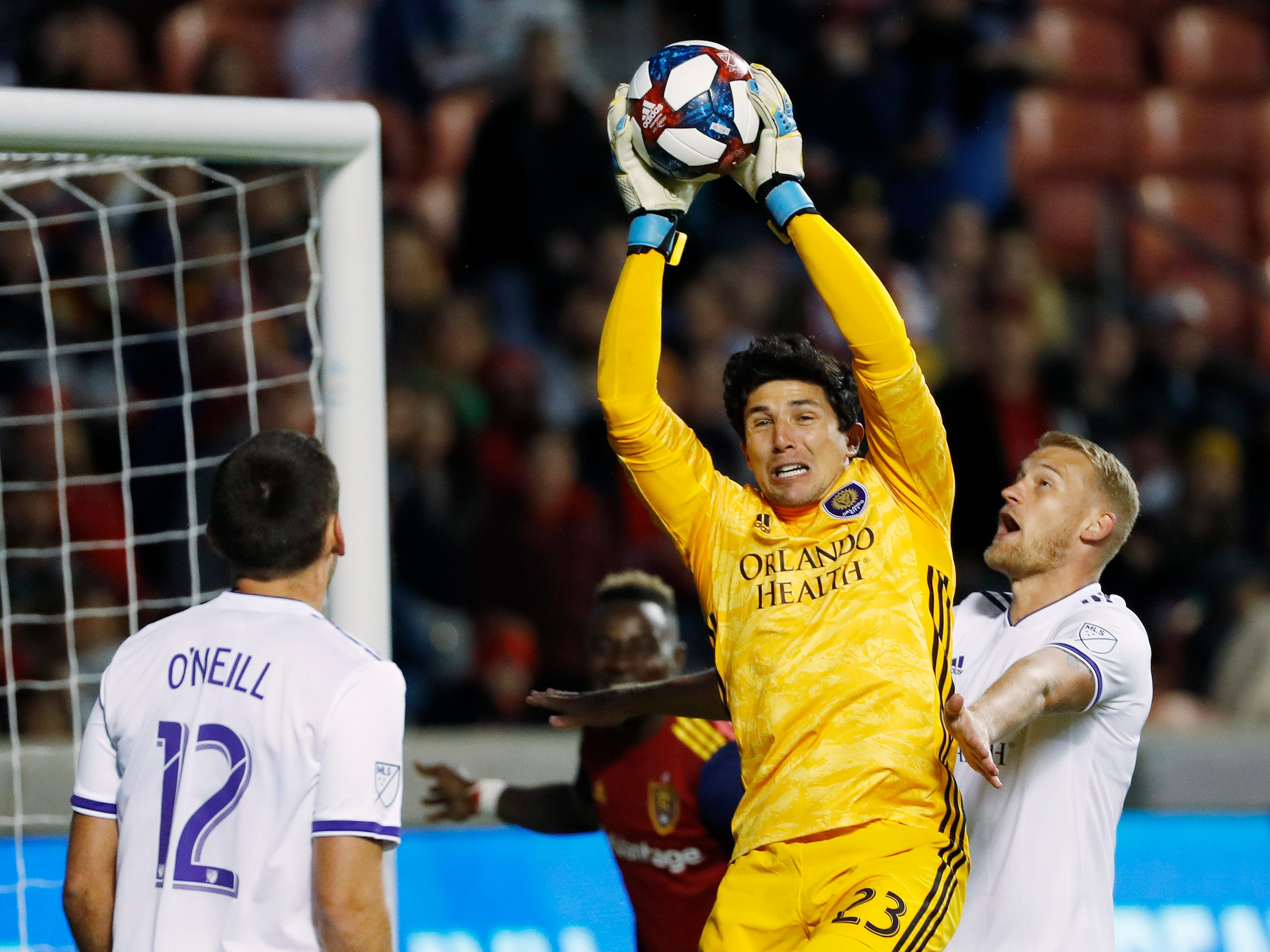 April 13: Orlando City goalkeeper Brian Rowe (23) makes a save in front of his teammates defender Shane O'Neill (12) and defender Robin Jansson (6) against Real Salt Lake in the second half at Rio Tinto Stadium. Real Salt Lake won the game, 2-1.
