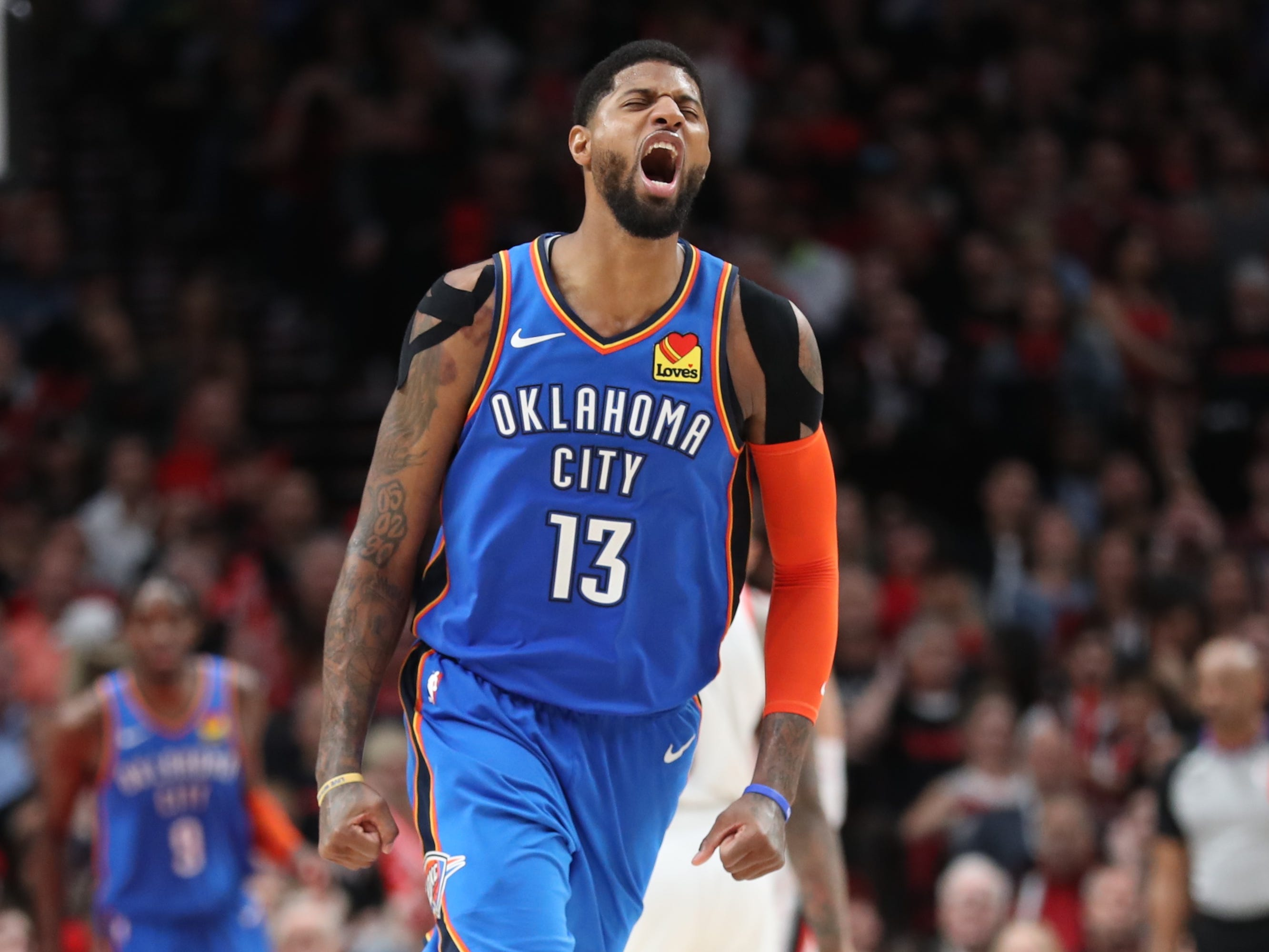 April 14: Thunder forward Paul George reacts after making a 3-point shot in the second half of Game 1 against the Trail Blazers.