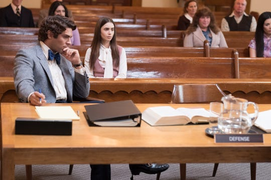 "Ted Bundy (Zac Efron, left) gets moral support in court from girlfriend Liz (Lily Collins) the Netflix drama ""Extremely Wicked, Shockingly Evil, and Vile."" (May 3). (Photo: BRIAN DOUGLAS)"