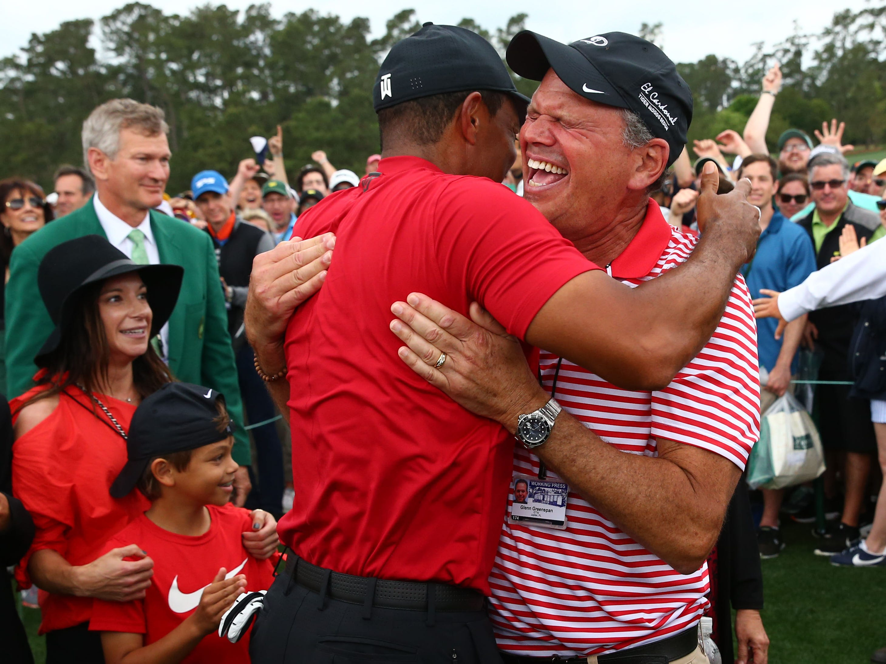 Tiger Woods hugs his chief spokesperson, Glenn Greenspan after winning The Masters.