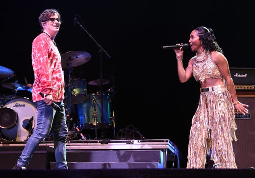 Rozonda 'Chilli' Thomas of TLC gleamed in a gold metallic ensemble during her duet with Weezer's Rivers Cuomo April 13 at Coachella.