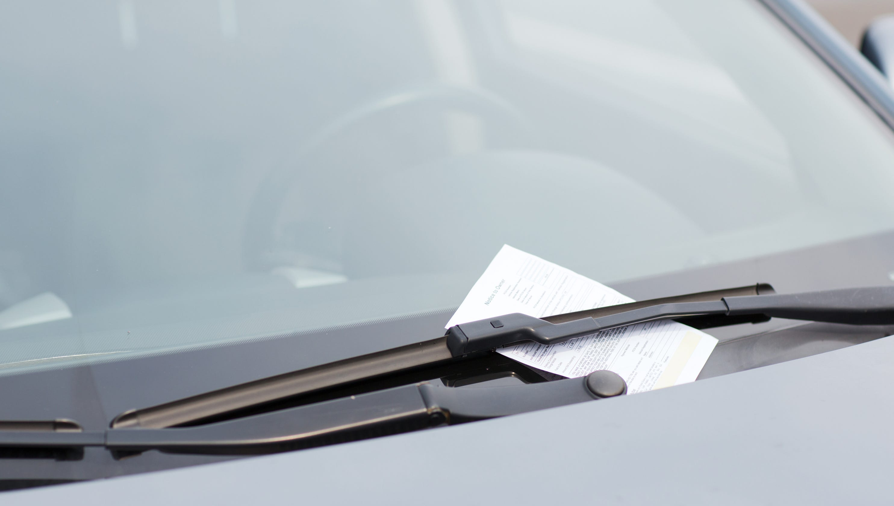 Mom fights parking ticket, almost being towed while breastfeeding her 3-week-old baby