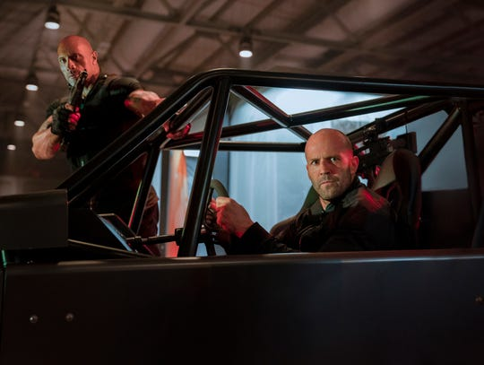 "Frenemies Luke Hobbs (Dwayne Johnson, left) and Deckard Shaw (Jason Staham) team up to take on a supervillain in the action film ""Fasy & Furious Presents: Hobbs & Shaw."" (Aug. 2) (Photo: DANIEL SMITH)"