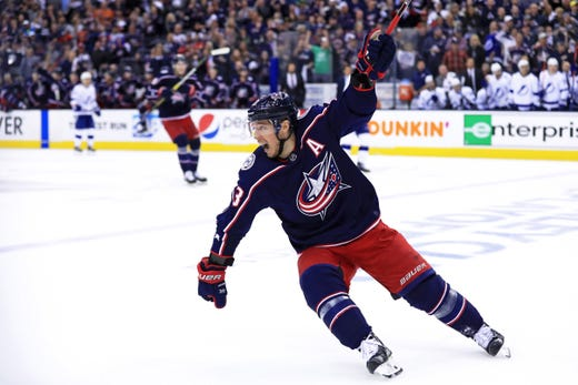 First round: Columbus Blue Jackets forward Cam Atkinson celebrates after scoring an empty-net goal against the Tampa Bay Lightning during the third period of Game 3.