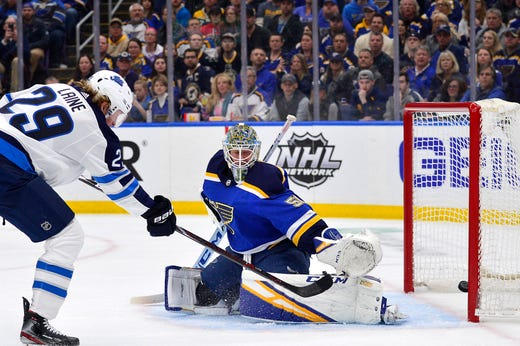 First round: Winnipeg Jets forward Patrik Laine scores a goal against the St. Louis Blues during the second period of Game 3.