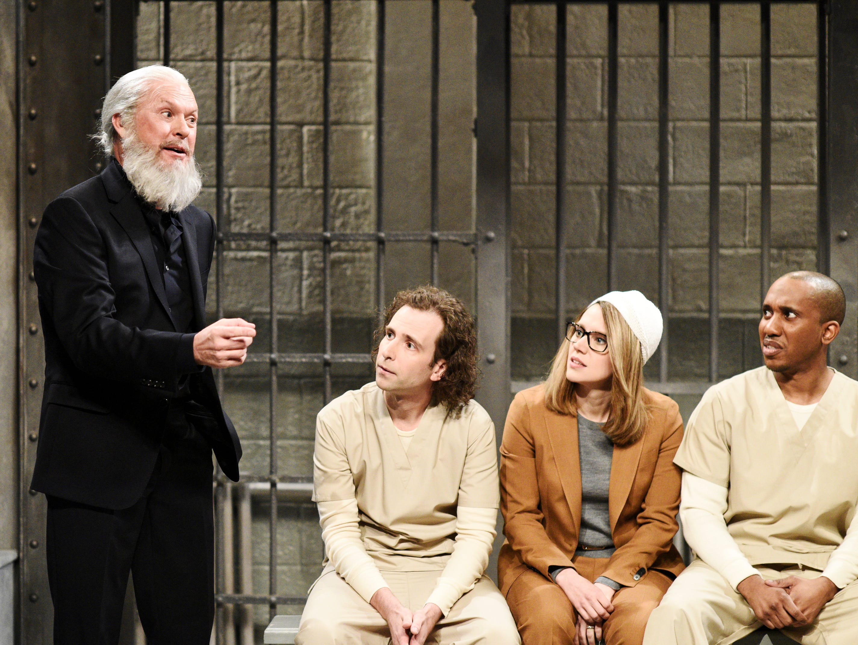 Michael Keaton made a surprise appearance as Julian Assange in the April 13 cold open that also included Kate McKinnon as actress Lori Loughlin and Kyle Mooney and Chris Redd as inmates stuck with jailed celebrities.