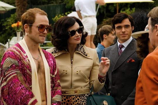 "Taron Egerton (left) stars as Elton John, Bryce Dallas Howard is his mother Sheila, and Richard Madden plays manager John Reid in the musical fantasy ""Rocketman."" (May 31)"