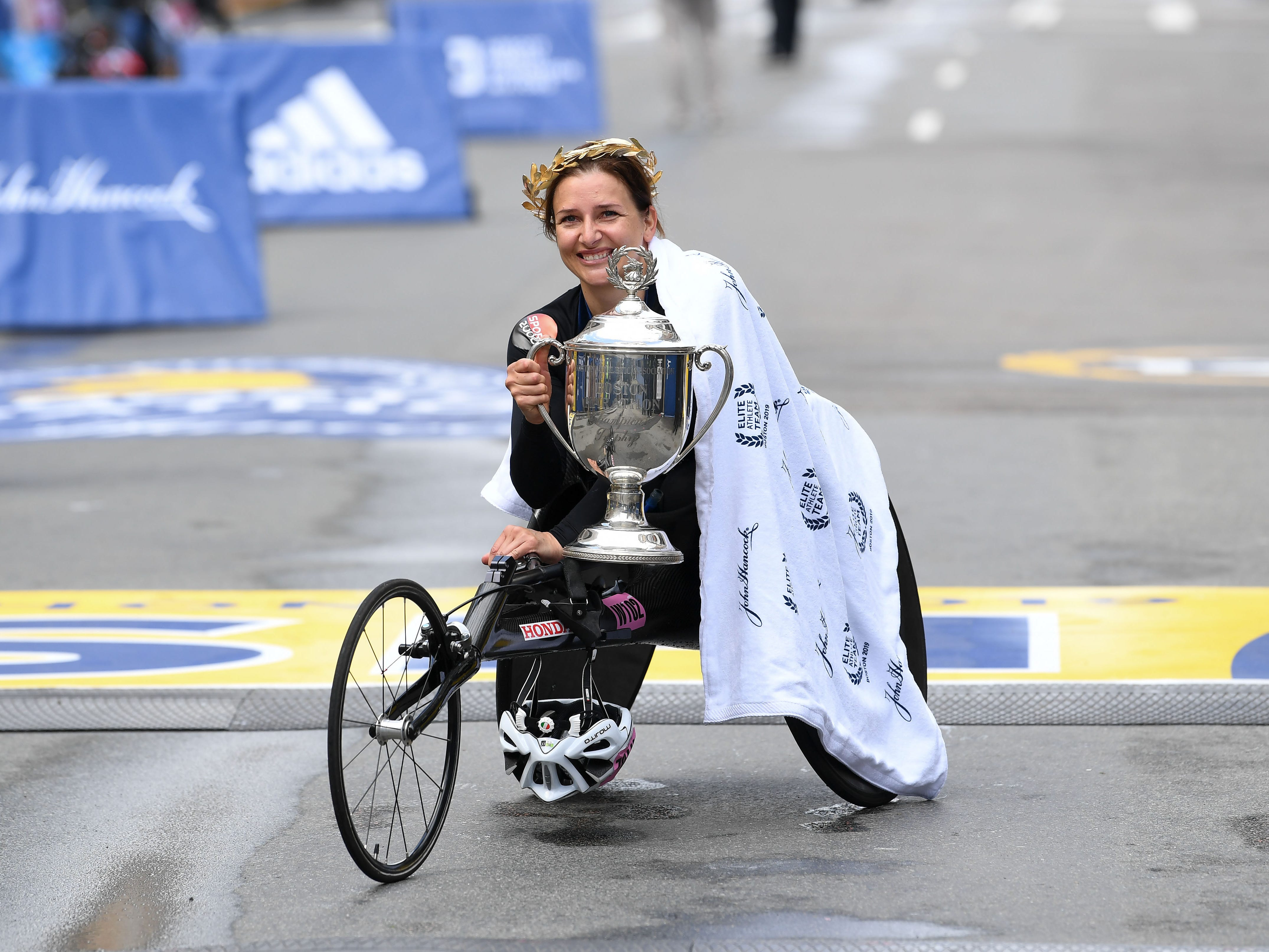 Manuela Schar of Switzerland holds the trophy after winning the women's wheelchair division in the 2019 Boston Marathon.
