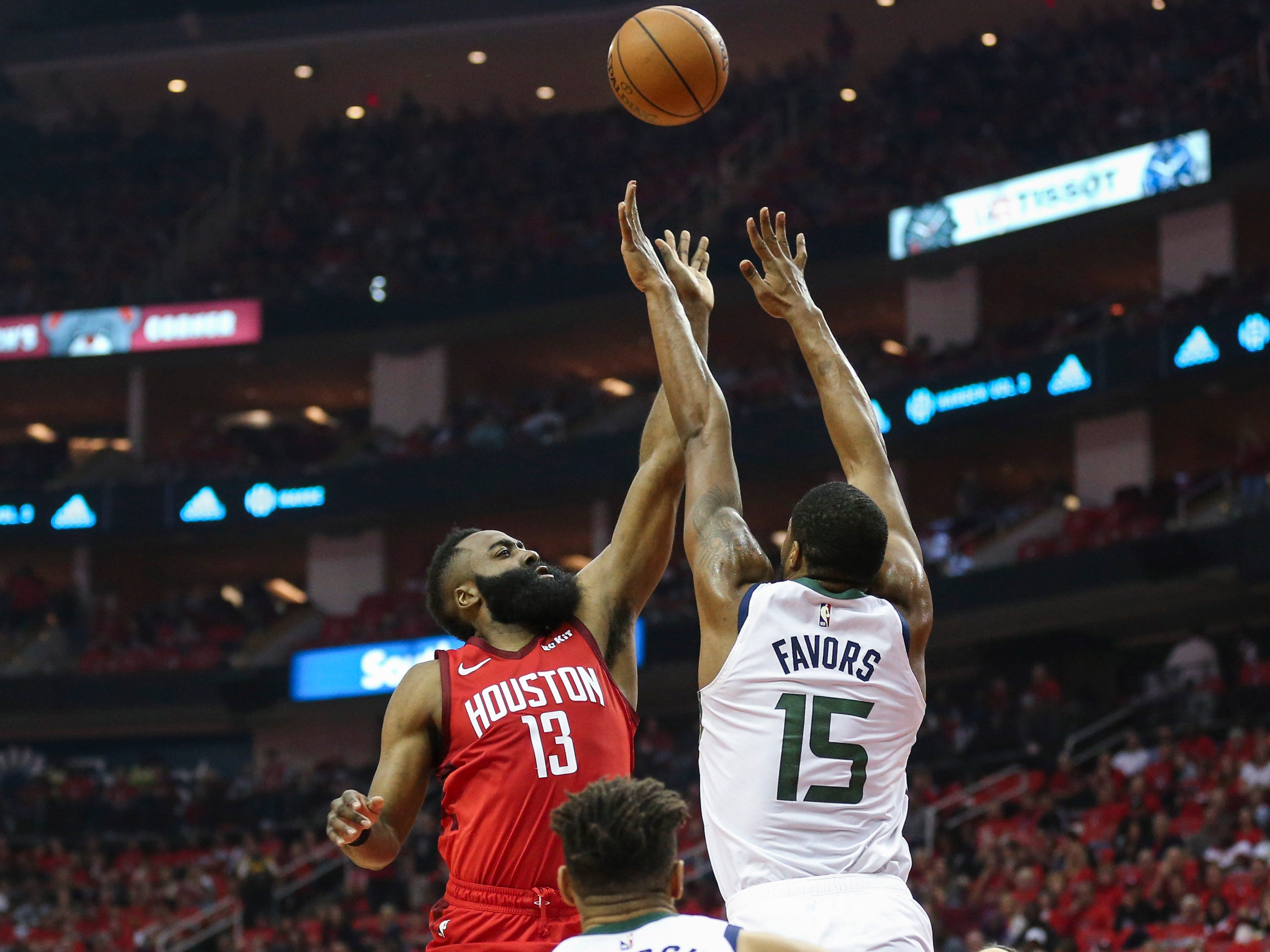 April 14: Rockets guard James Harden puts up a floater over Jazz defender Derrick Favors during Game 1 in Houston.