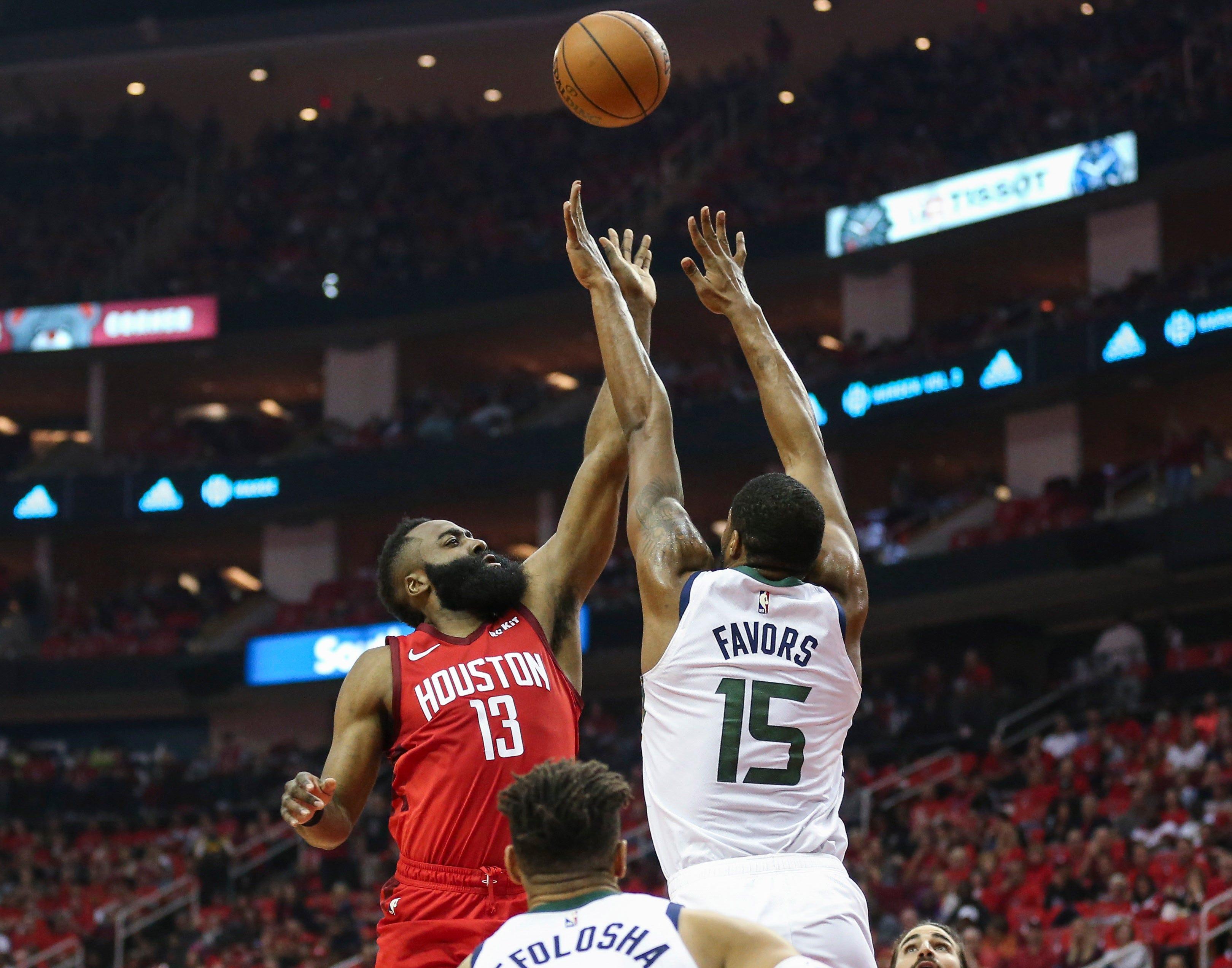 April 14: Rockets guard James Harden puts up a floater over Jazz defender Derrick Favors during Game 1 in Houston.