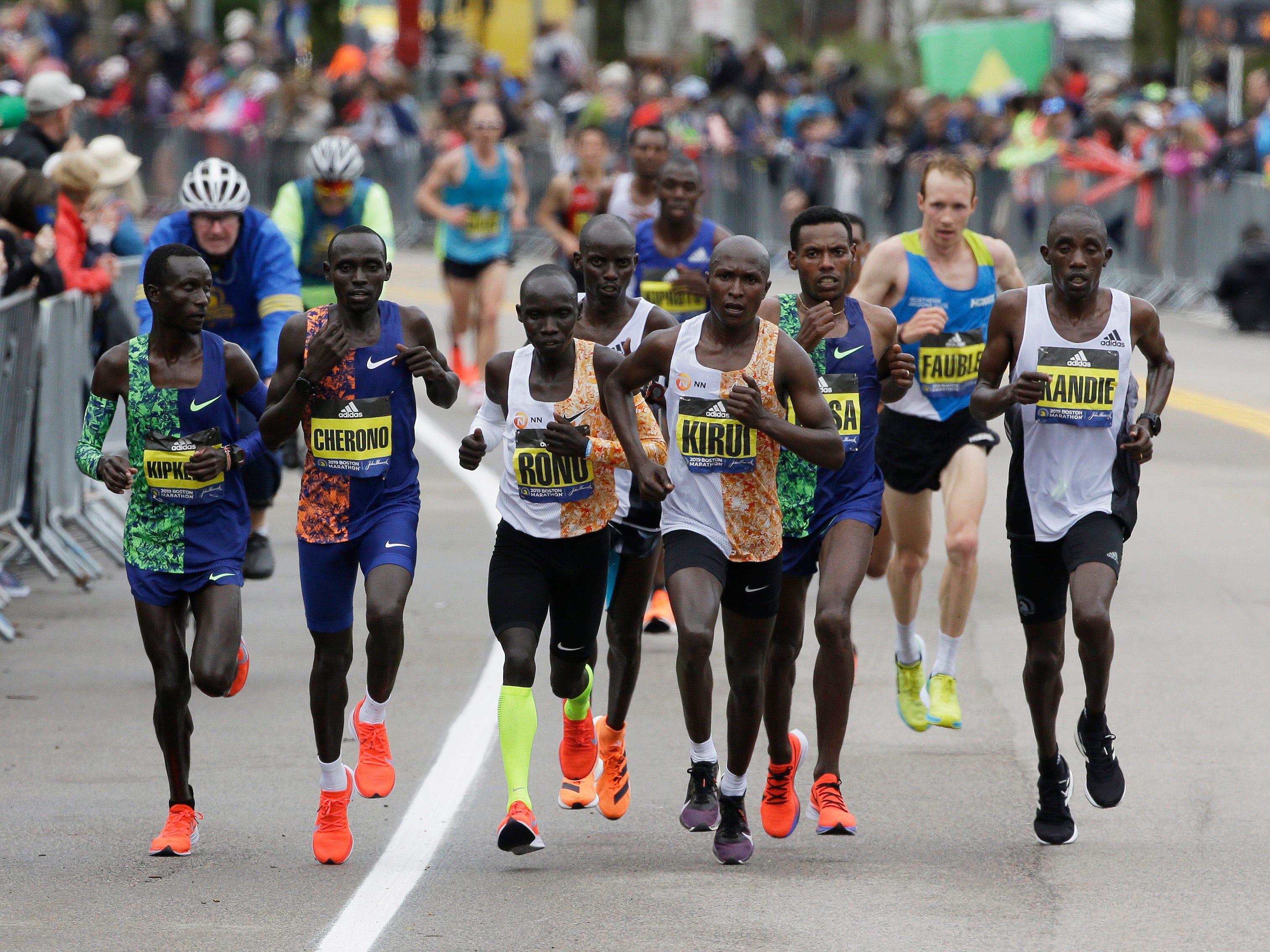 Geoffrey Kirui of Kenya leads the pack of runners up Heartbreak Hill during the 123rd Boston Marathon.