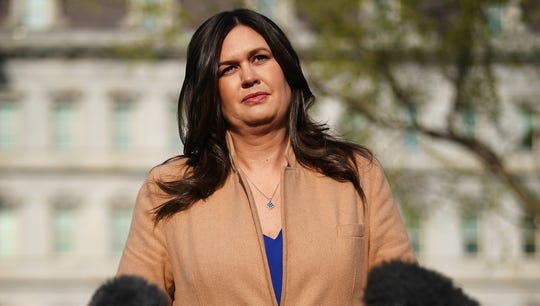 White House Press Secretary Sarah Sanders talks to reporters outside the West Wing of the White House on April 4, 2019, in Washington.