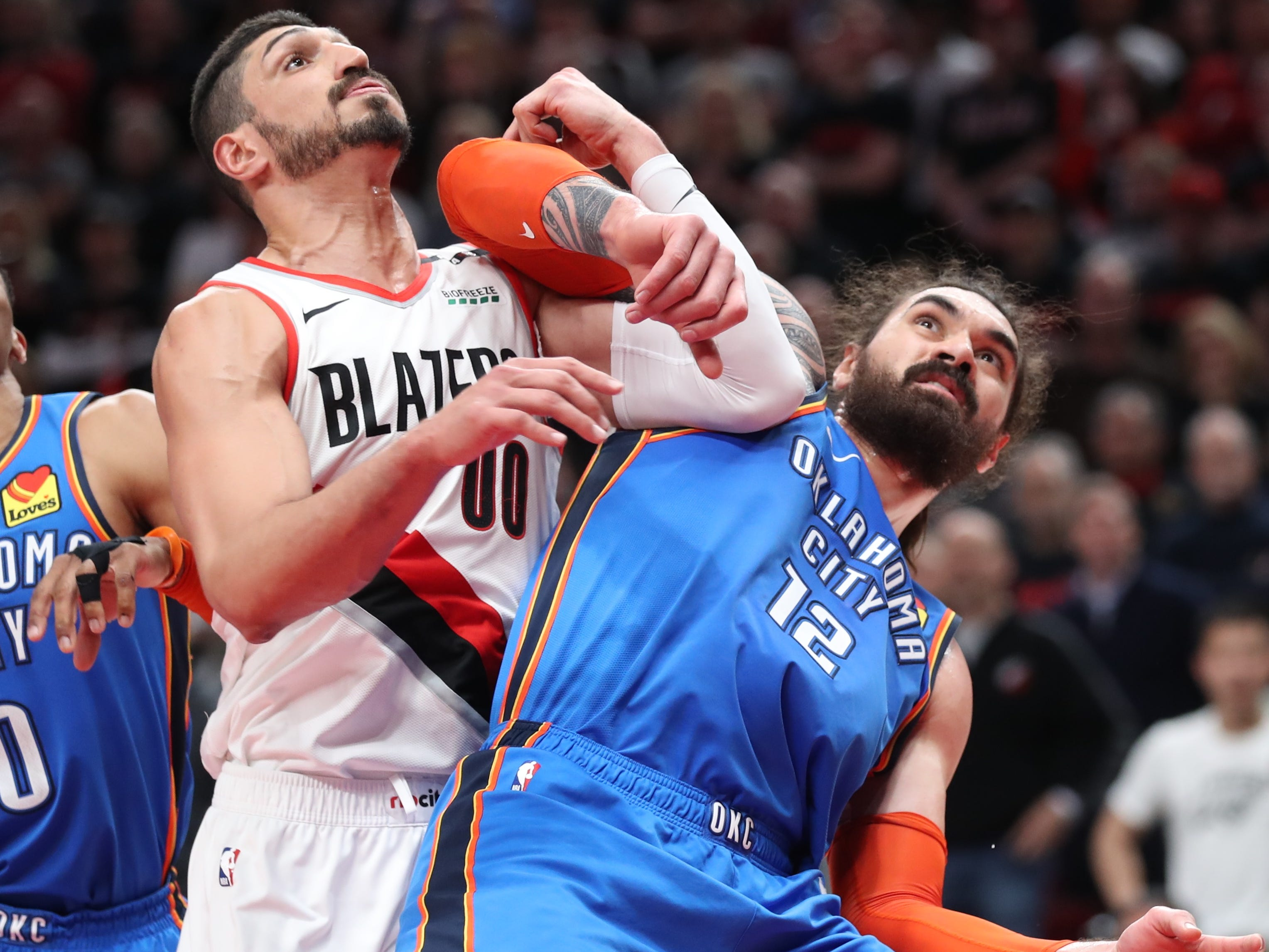 April 14: Trail Blazers center Enes Kanter and Thunder center Steven Adams jockey for rebound position during Game 1.