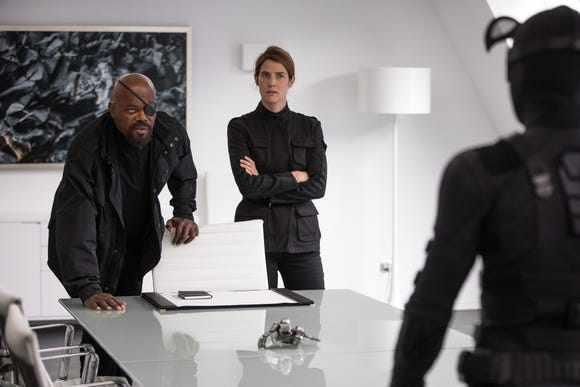 "Nick Fury (Samuel L. Jackson) and Maria Hill (Cobie Smulders) recruit Spider-Man (Tom Holland) for a new mission in ""Spider-Man: Far From Home."" (Photo: JAY MAIDMENT)"