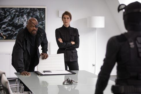 """Nick Fury (Samuel L. Jackson) and Maria Hill (Cobie Smulders) recruit Spider-Man (Tom Holland) for a new mission in """"Spider-Man: Far From Home."""""""