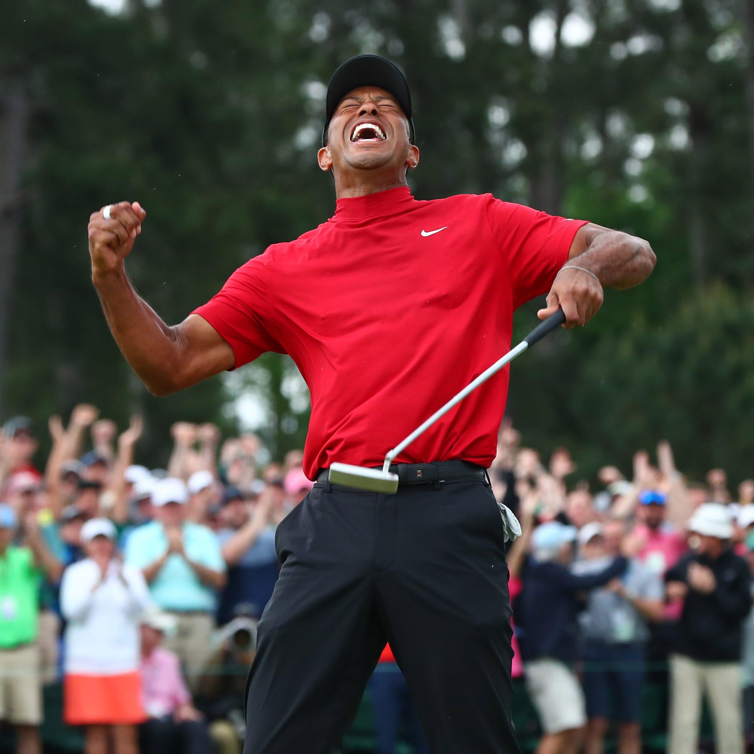 Tiger Woods celebrates winning The Masters.