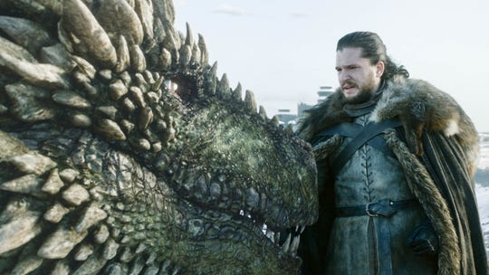 Jon Snow (Kit Harington) gets up and personal with a dragon...