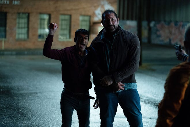 "An Uber driver (Kumail Nanjiani, left) gets mixed up with a detective (Dave Bautista) hunting a terrorist in the action comedy ""Stuber."" (July 12)"