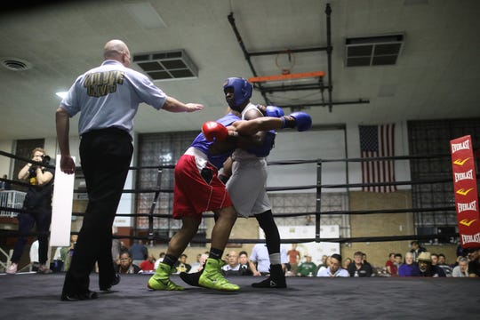 "Abimbola ""Abel"" Osundairo, right, fights Xavier Morales in a 178-pound semifinal bout at the Golden Gloves boxing tournament March 21, 2019, at Cicero Stadium in Cicero, Ill."