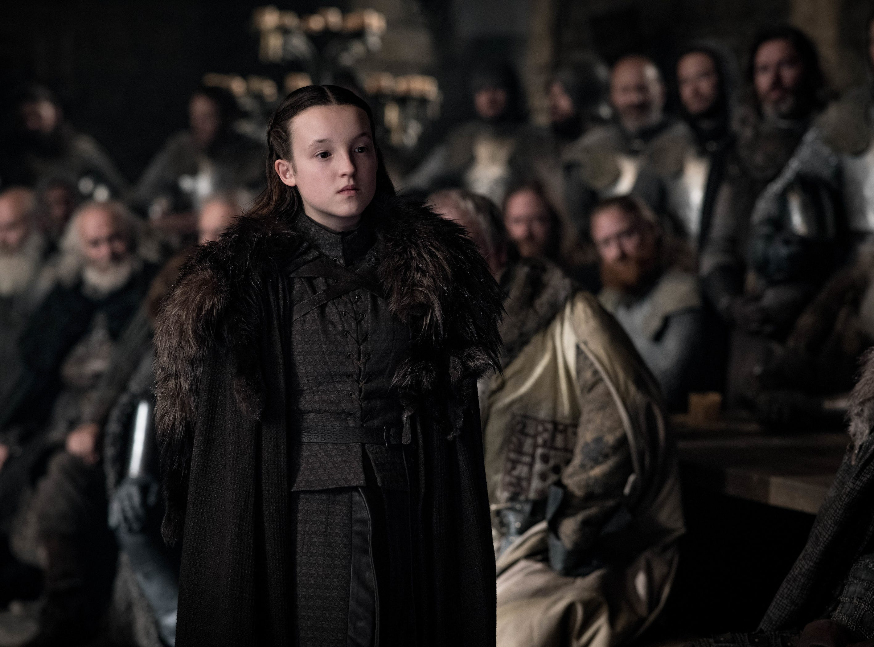 Lyanna Mormont (Bella Ramsey) raises objections during a meeting at Winterfell.