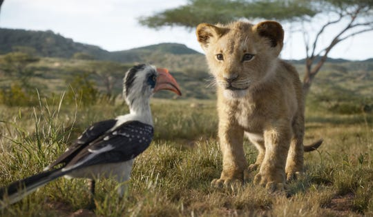 "Young Simba (voiced by JD McCrary, right) chats with his dad's loyal majordomo Zazu (John Oliver) in ""The Lion King."""