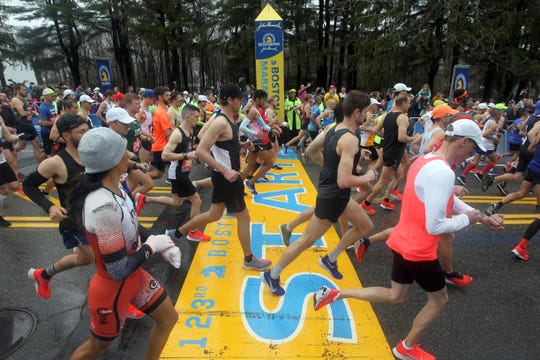 Runners cross the start line of the 123rd Boston Marathon.