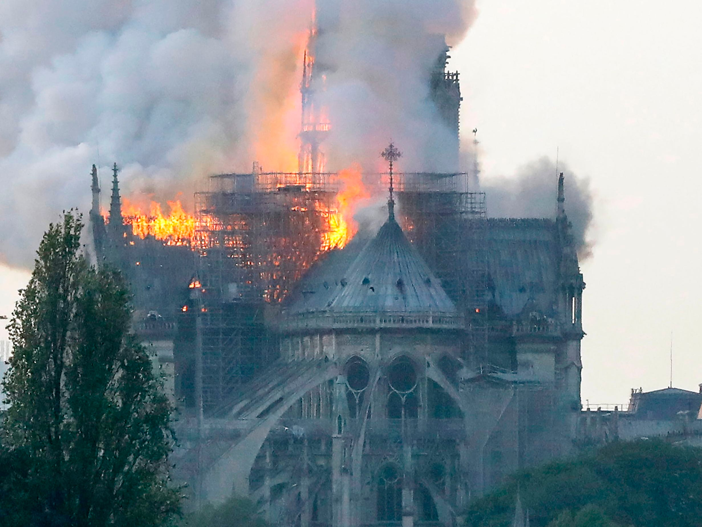 Smoke ascends as flames rise during a fire at the landmark Notre Dame Cathedral.