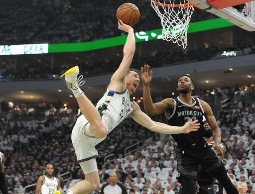 April 14: Bucks forward Pat Connaughton gets fouled on his way to the bucket during Game 1 against the Pistons.