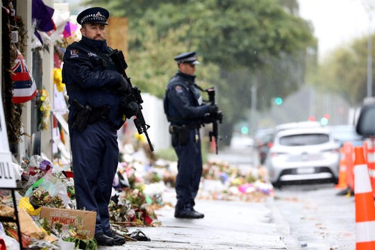 Armed police officers stand guard outside the Al Noor mosque, one of the mosques where some 50 people were killed by a self-avowed white supremacist gunman on March 15, in Christchurch on April 5, 2019. - The man accused of shooting dead 50 Muslim worshippers in a Christchurch mosque sat impassively earlier on April 5 as a New Zealand judge ordered him to undergo tests to determine if he is mentally fit to stand trial for murder.
