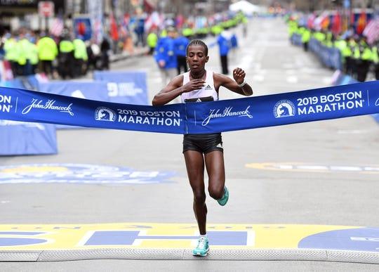 Worknesh Degefa of Ethiopia crosses the finish line to win the 2019 Boston Marathon.