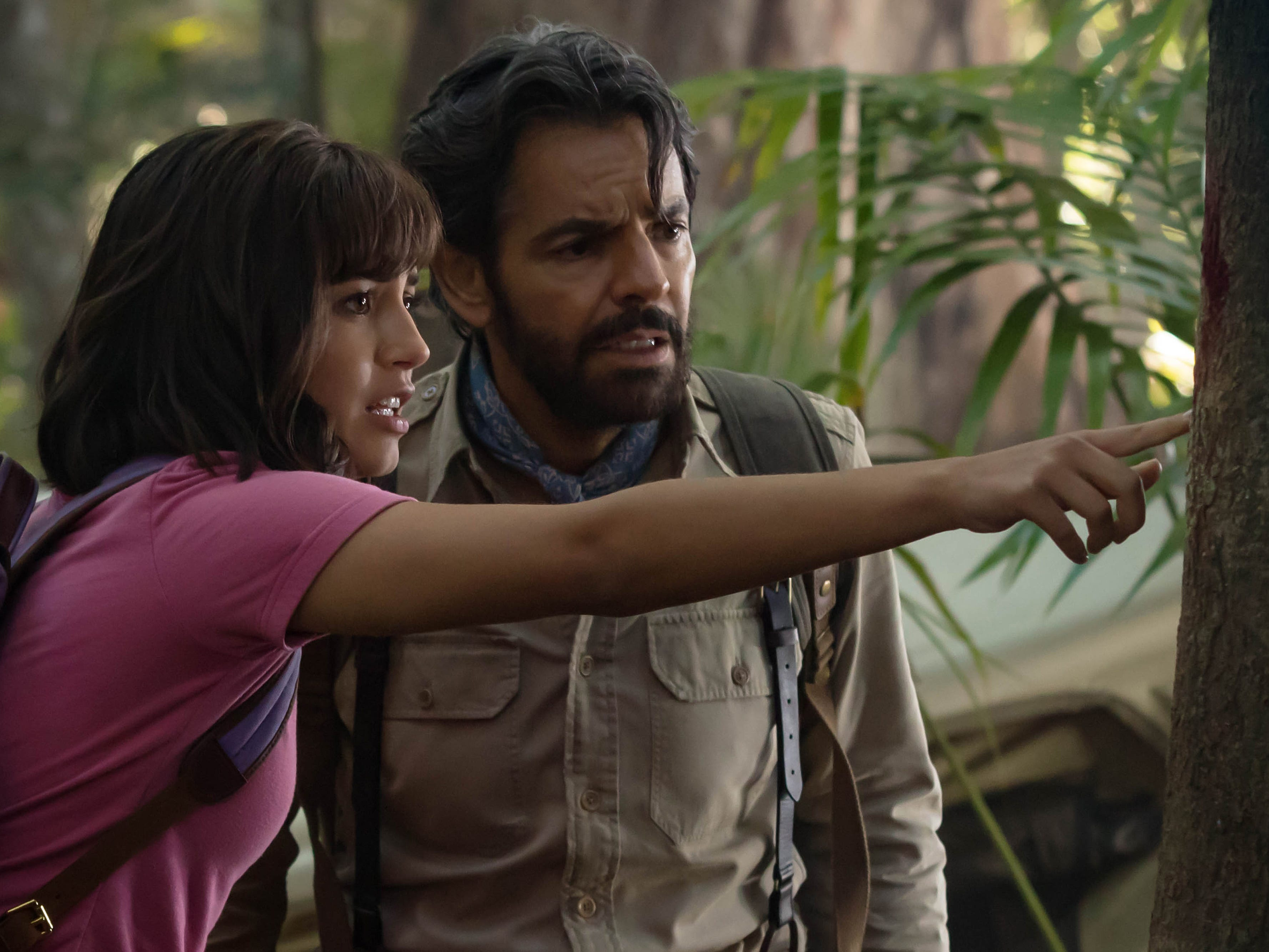 "Isabela Moner (left, with Eugenio Derbez) stars as teenage explorer Dora in the kid-friendly adventure ""Dora and the Lost City of Gold."" (July 31)"