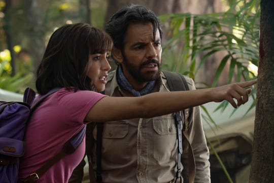 """Isabela Moner (left, with Eugenio Derbez) stars as teenage explorer Dora in the kid-friendly adventure """"Dora and the Lost City of Gold."""""""