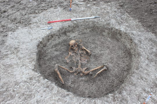 "A team laying pipes at a chalk stream in Oxfordshire, England, uncovered an ancient settlement with 26 skeletons, some of which may have been part of ""human sacrifice,"" archaeologists said."
