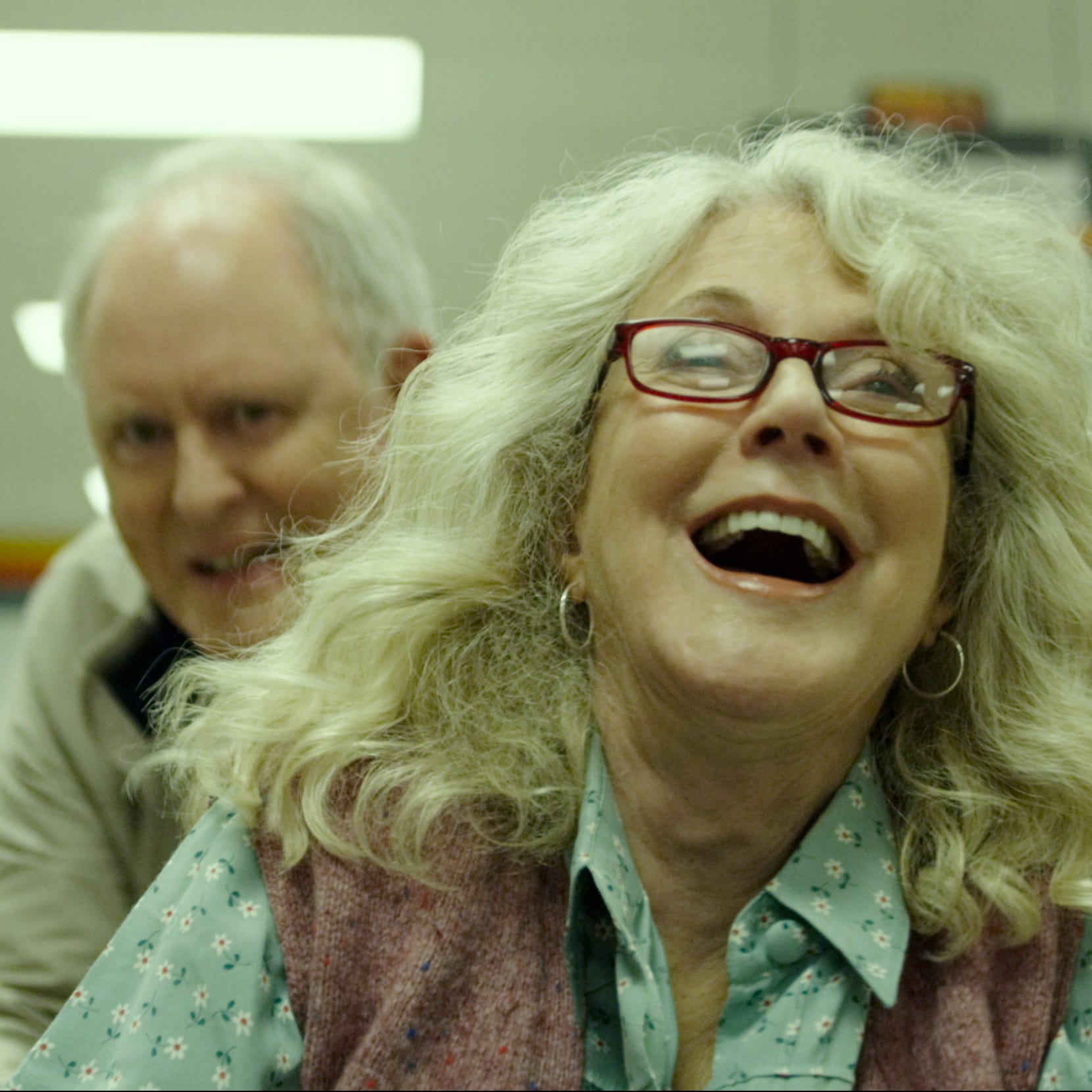 """John Lithgow and Blythe Danner star as two eccentric small-town hoarders who fall in love in the romantic drama """"The Tomorrow Man."""" (May 22)"""