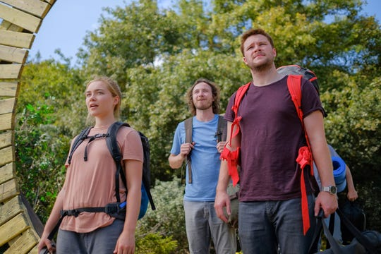 "Florence Pugh (from left), Vilhelm Blomgren and Jack Reynor are tourists who discover the terrifying secrets of the Swedish village they visit in the horror film ""Midsommar."" (July 3)"