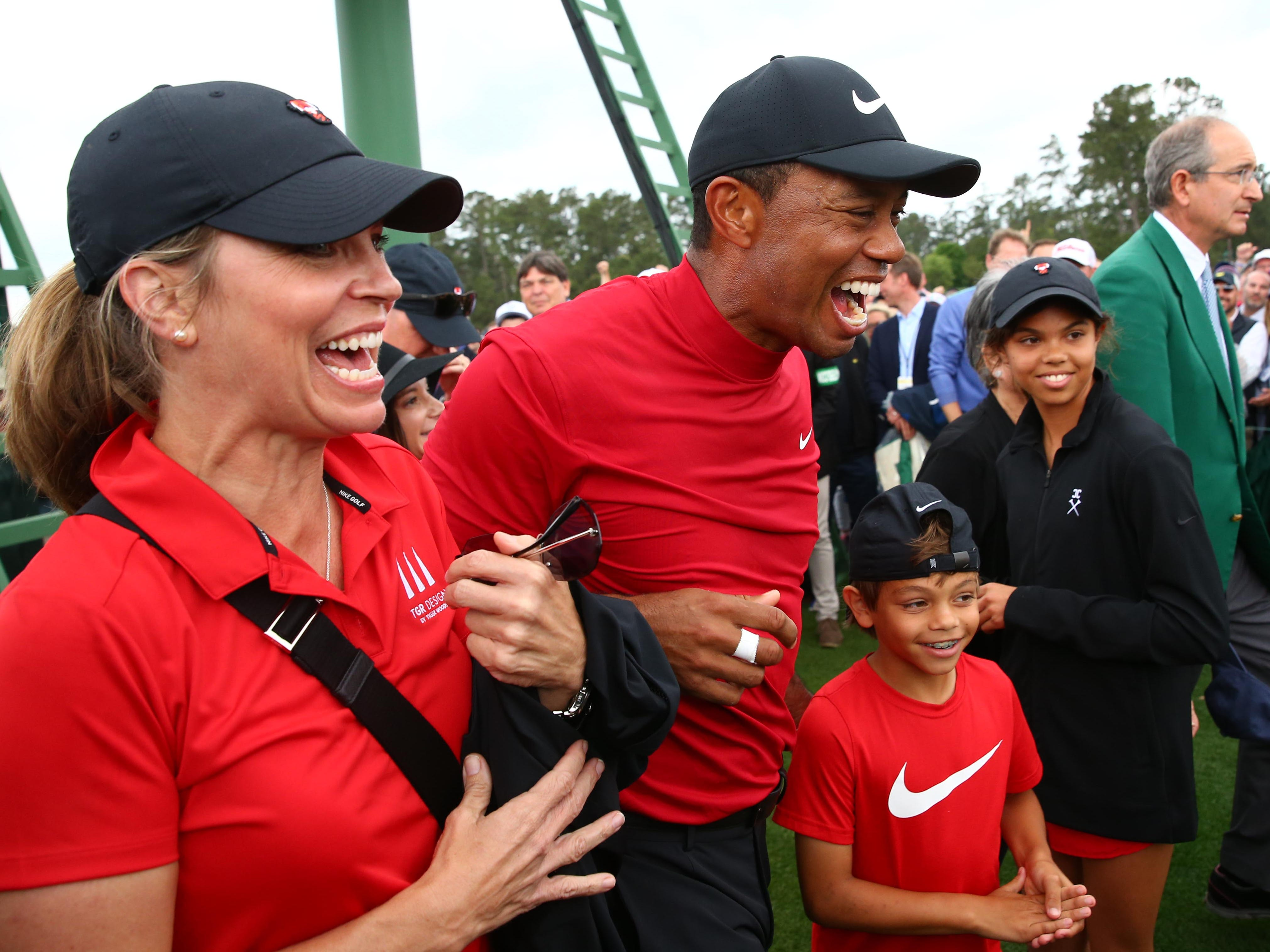 Apr 14, 2019; Augusta, GA, USA; Tiger Woods celebrates with daughter Sam and son Charlie after winning The Masters golf tournament at Augusta National Golf Club. Mandatory Credit: Rob Schumacher-USA TODAY Sports ORG XMIT: USATSI-389786 ORIG FILE ID:  20190414_jla_usa_274.jpg