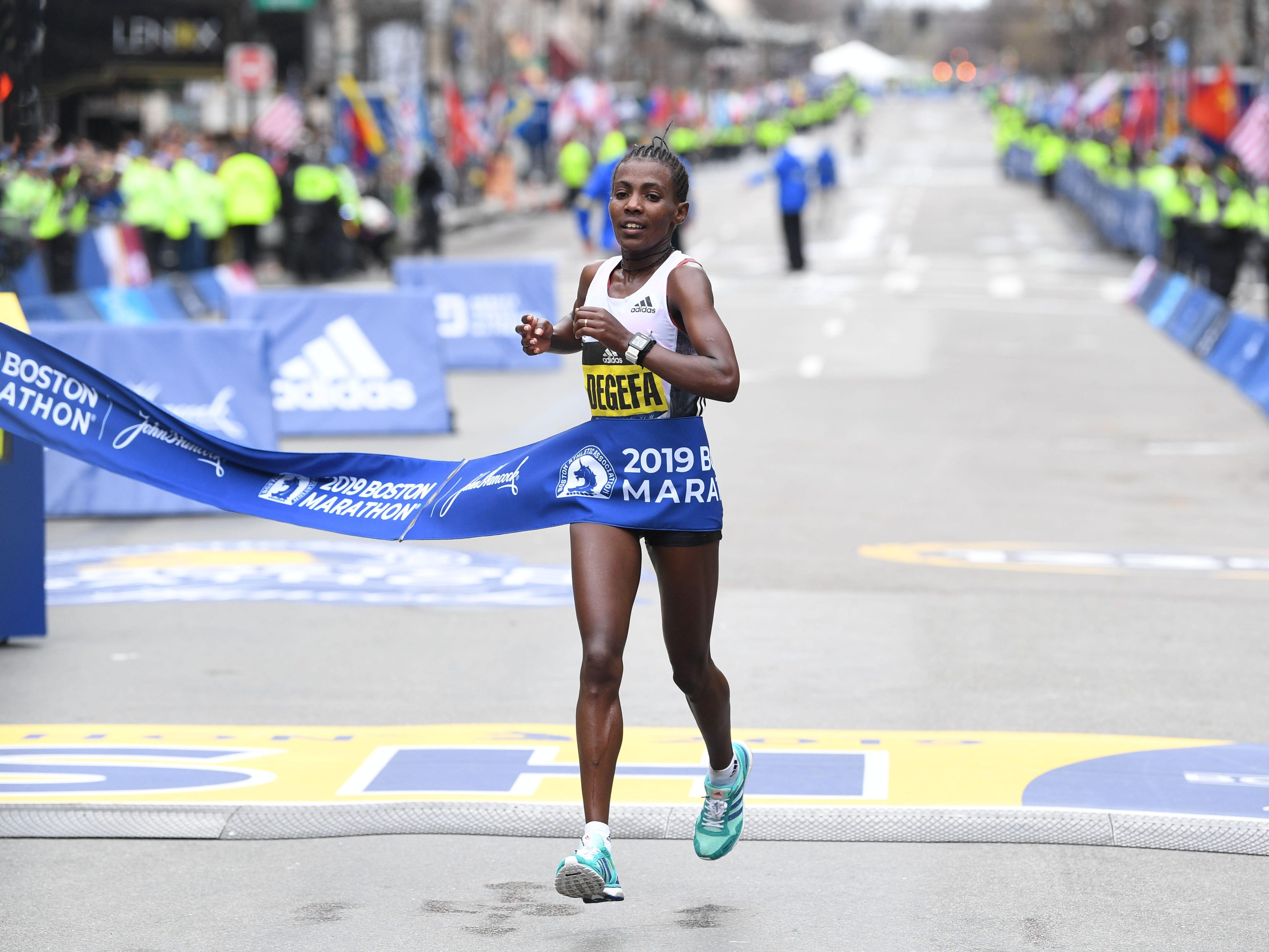 Worknesh Degefa (ETH) crosses the finish line to win the 2019 Boston Marathon.
