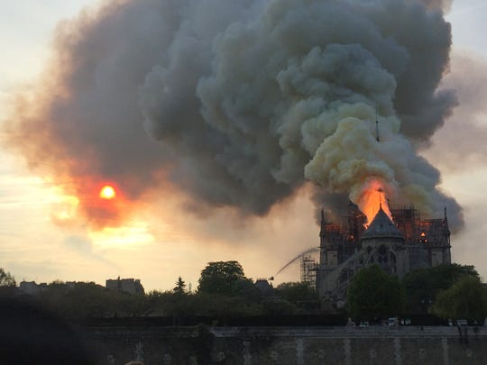 Flames and smoke billow from the roof of the Notre Dame Cathedral in Paris on April 15, 2019.