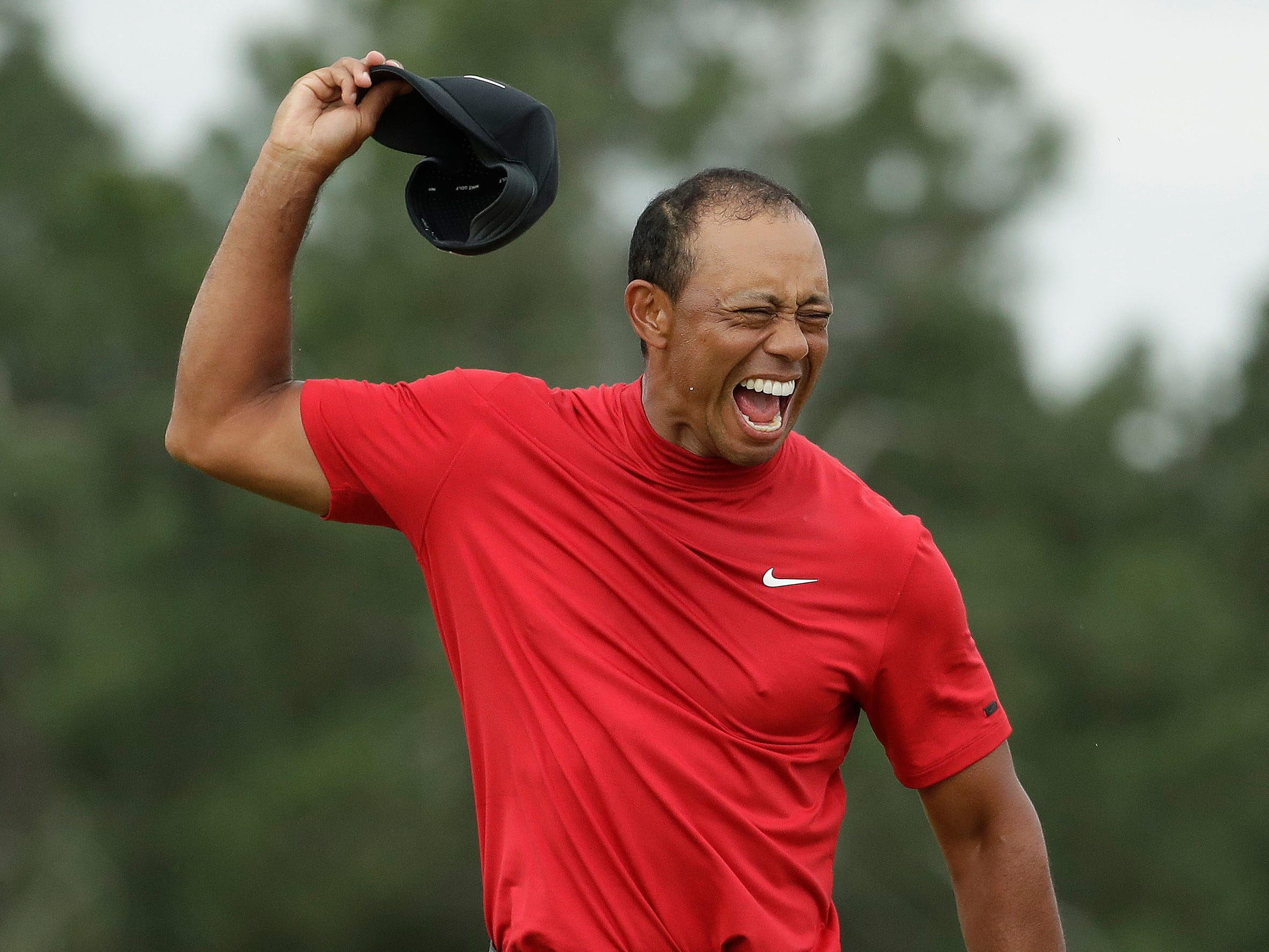Tiger Woods reacts as he wins the Masters golf tournament.