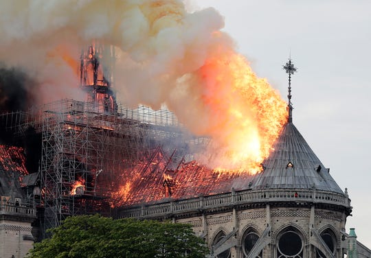 Flames burn the roof of Notre-Dame Cathedral in Paris on April 15, 2019.