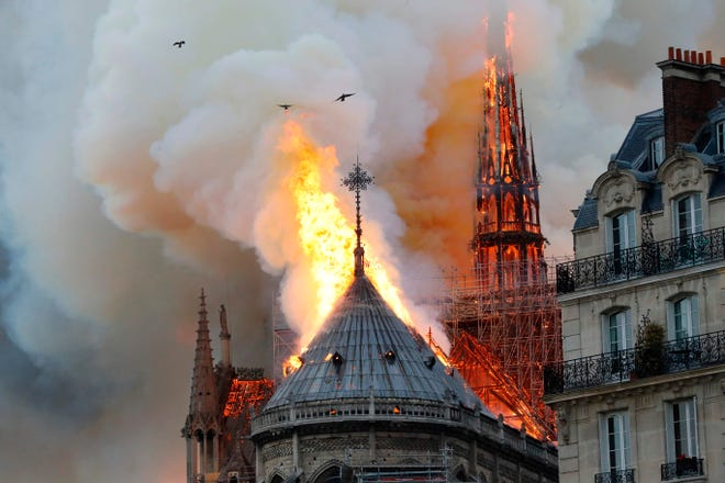 Smoke and flames rise during a fire at the Notre Dame Cathedral.