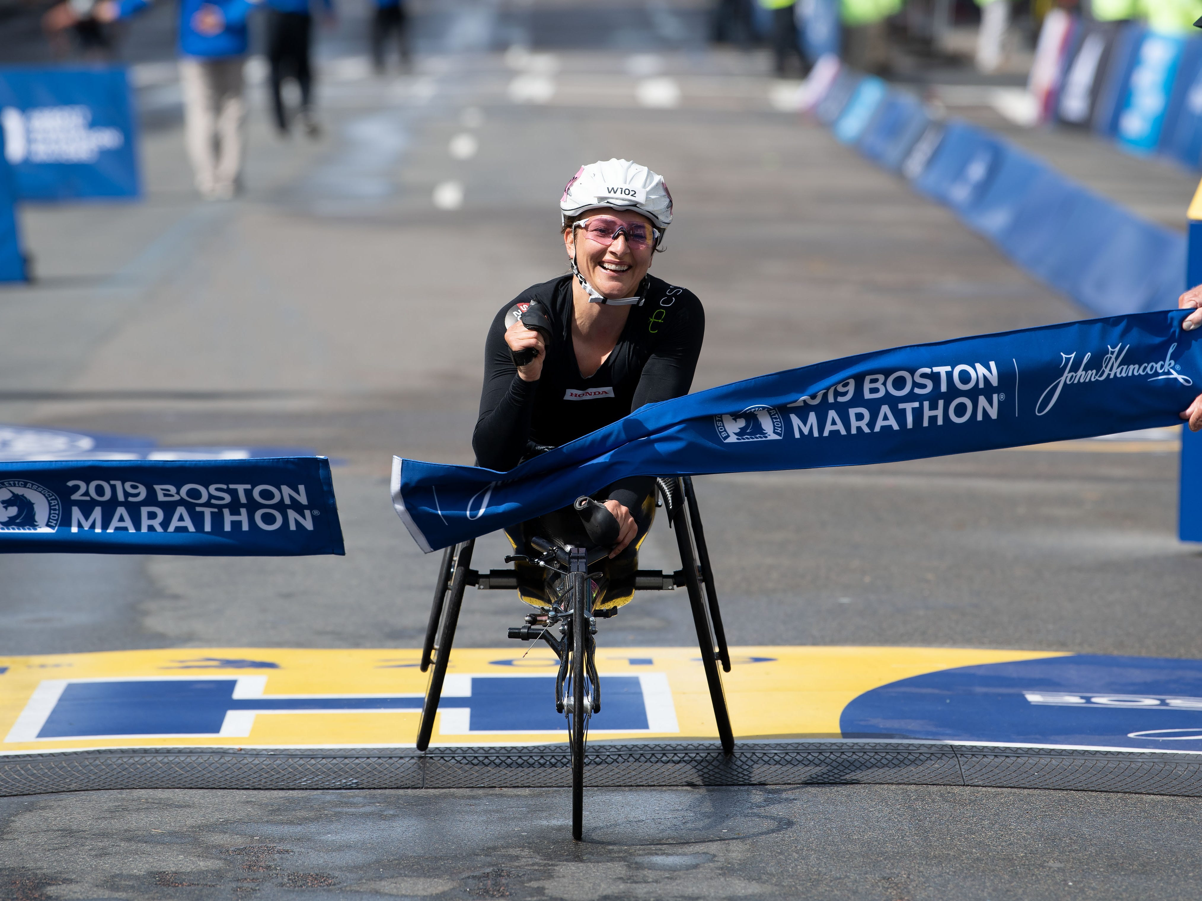 Manuela Schar of Switzerland crosses the finish line to win the women's wheelchair division in the 2019 Boston Marathon.