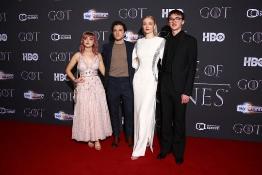 "The four surviving Stark children – well, technically, three Starks and their Targaryen cousin – posed together April 12 at the ""Game of Thrones"" premiere in Belfast Ireland, where the Winterfell scenes were shot. (From left: Actors Maisie Williams, from left, Kit Harington, Sophie Turner and Isaac Hempstead)"