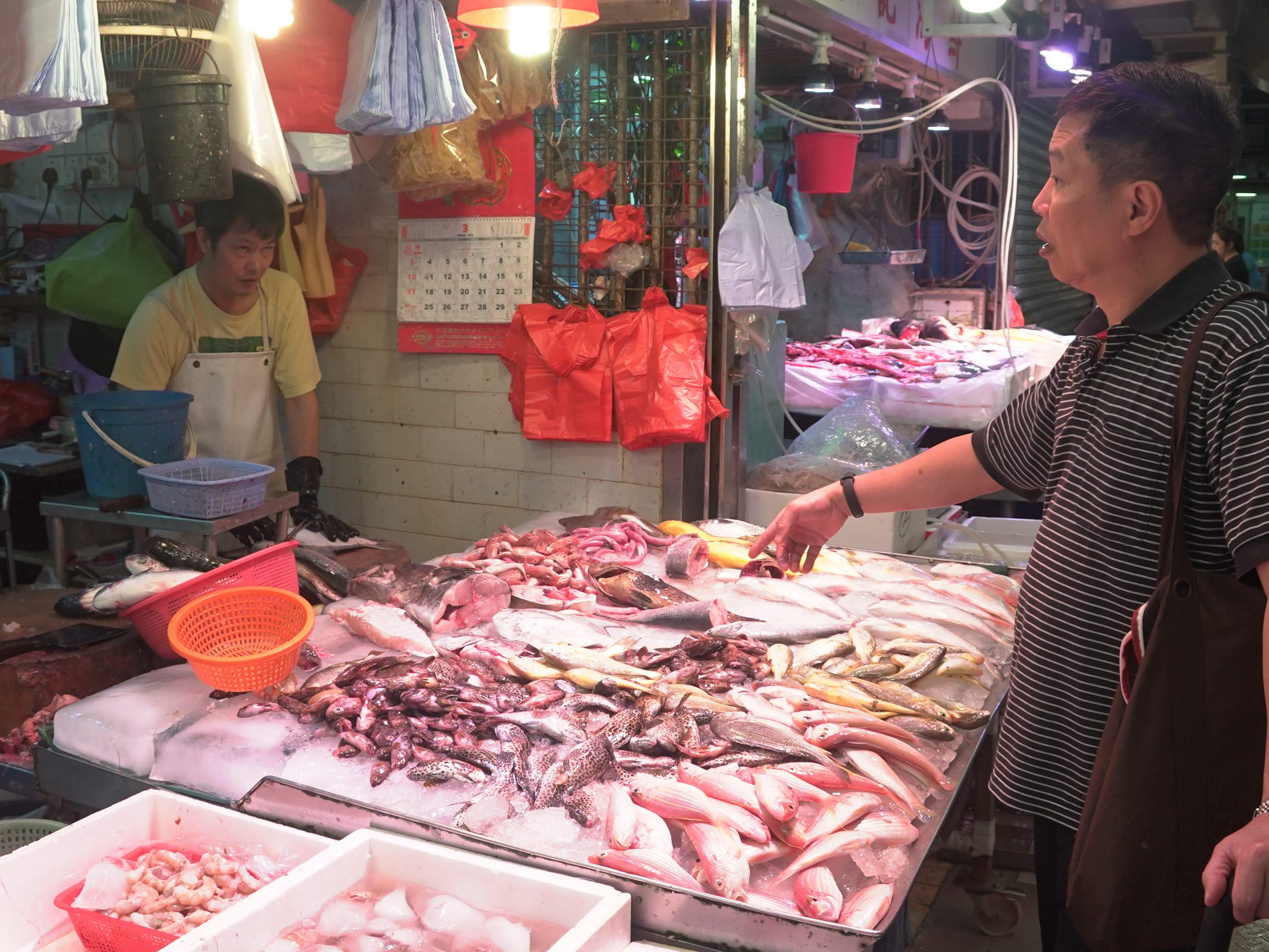 Daily life at a Hong Kong wet market.