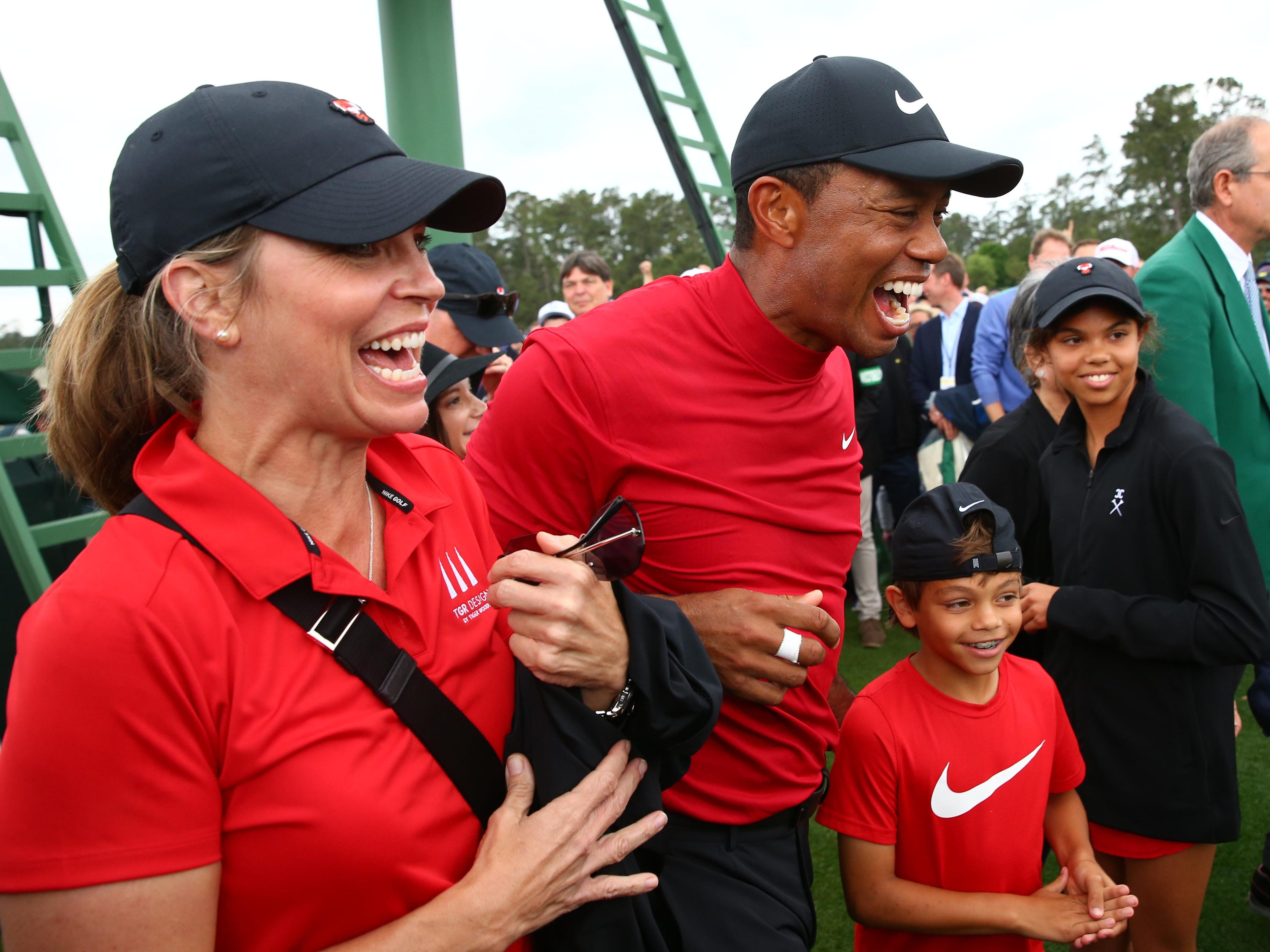 Tiger Woods celebrates with daughter Sam and son Charlie.