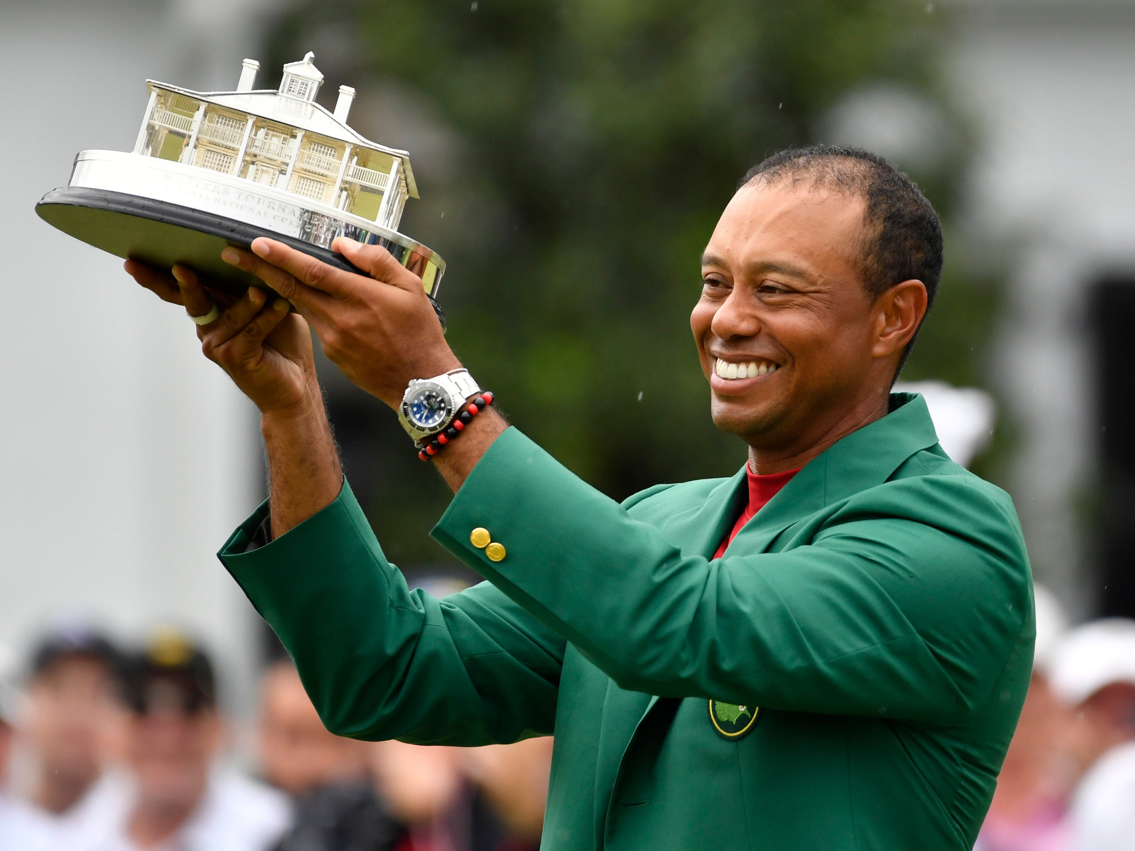 Apr 14, 2019; Augusta, GA, USA; Tiger Woods celebrates with the green jacket and trophy after winning The Masters golf tournament at Augusta National Golf Club. Mandatory Credit: Michael Madrid-USA TODAY Sports ORG XMIT: USATSI-389786 ORIG FILE ID:  20190414_jla_mm1_290.jpg