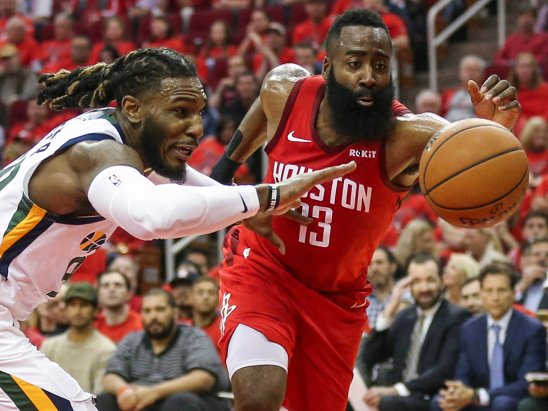 April 14: Rockets guard James Harden and Jazz forward Jae Crowder scramble for a loose ball during Game 1.